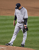 New York Yankees pitcher Freddy Garcia (36) bows his head after another wild pitch in the fifth inning against the Baltimore Orioles at Oriole Park at Camden Yards in Baltimore, MD on Tuesday, April 10, 2012..Credit: Ron Sachs / CNP.(RESTRICTION: NO New York or New Jersey Newspapers or newspapers within a 75 mile radius of New York City)