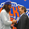 Jeff Hornacek, Head Coach of the New York Knicks, right, shakes hands with free agent signee Joakim Noah at Noah's introductory news conference at Madsion Square Garden Training Center in Greenburgh, NY on Friday, July 8, 2016.