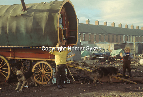 Gypsy family mother children Belfast 1969. Traditional horse drawn caravan.