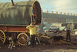 Irish Travellers   family mother children Belfast 1969. Northern Ireland. Traditional horse drawn caravan. 1960s UK. Traditional Bow top wagon with wooden spoke wagon wheels.
