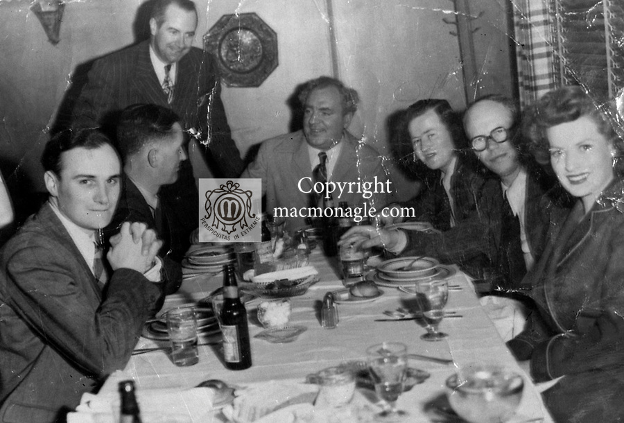 Donal MacMonagle, photographer with the Irish Press pictured in Hollywood, California with members of the Irish press corps including Arthur Quinlan and  with movie star Maureen O'Hara on right. .From macmonagle library