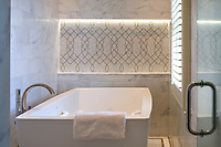 Luc, a hand-cut mosaic shown in polished Afyon White and  Sylvia Gold, is part of the Aurora® collection by Sara Baldwin for New Ravenna. Master Bath Design by Meghan Browne