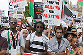 London, UK. 26 July 2014. Protesters gather in Parliament Square and Whitehall after a march from the Israeli Embassy in Kensington to call for an end to the Israeli military action against the Palestinians in the Gaza Strip at a political rallye.