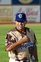 Ogden Raptors hitting coach Leo Garcia (26) comes onto the field as the Raptors faced the Great Falls Voyagers at Lindquist Field on August 16, 2013 in Ogden Utah. Military Appreciation Night saw the Raptors take the field in camouflage uniforms. (Stephen Smith/Four Seam Images)