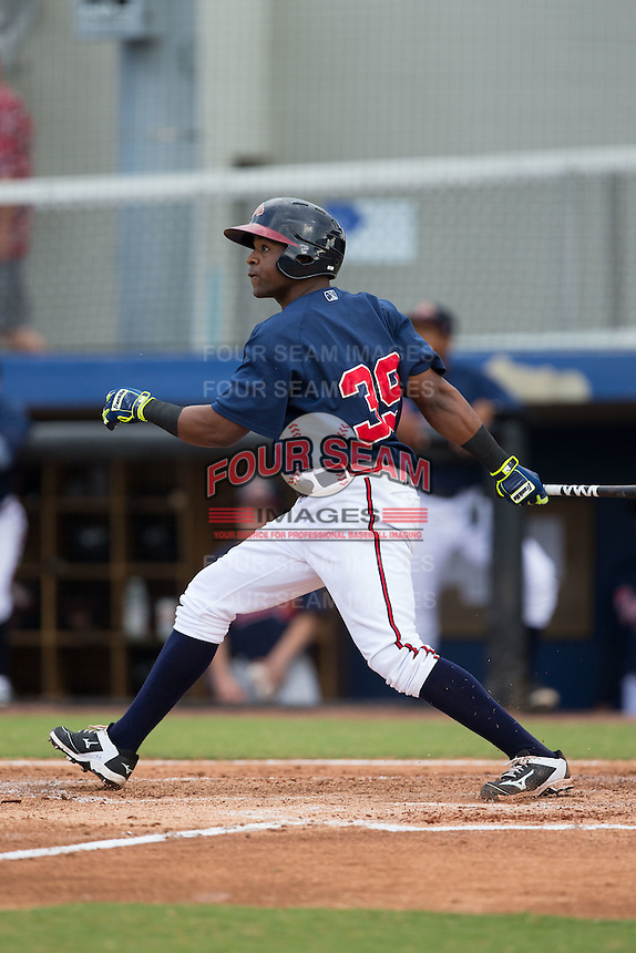Elias Arias (39) of the Danville Braves follows through on his swing against the Pulaski Yankees at American Legion Post 325 Field on July 31, 2016 in Danville, Virginia.  The Yankees defeated the Braves 8-3.  (Brian Westerholt/Four Seam Images)