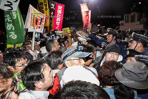 Protestors face off against the police during a protest against proposed new security legislation in front of the National Parliament on September 16, 2015, Tokyo, Japan. SEALDs members and many people from different walks of life joined the now daily gathering against Prime Minister Shinzo Abe's push to secure final approval for new security bills that could allow Japanese troops to fight overseas for the first time in 70 years. (Photo by Rodrigo Reyes Marin/AFLO)