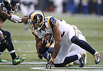 St. Louis Rams Trumaine Johnson (21) gets up after intercepting a pass intended for Seattle Seahawks wide receiver Tyler Lockett at CenturyLink Field in Seattle, Washington on December 27, 2015.  The Rams beat the Seahawks 23-17.      ©2015. Jim Bryant Photo. All Rights Reserved