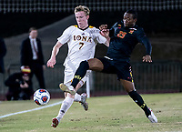 COLLEGE PARK, MD - NOVEMBER 21: Fola Adetola #29 of Maryland moves in on Josh Plimpton #7 of Iona during a game between Iona College and University of Maryland at Ludwig Field on November 21, 2019 in College Park, Maryland.