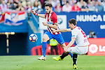 Saul Niguez Esclapez (l) of Atletico de Madrid is challenged by Clement Lenglet of Sevilla FC during their La Liga match between Atletico de Madrid and Sevilla FC at the Estadio Vicente Calderon on 19 March 2017 in Madrid, Spain. Photo by Diego Gonzalez Souto / Power Sport Images