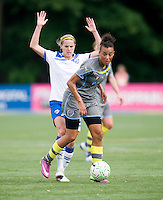 Lianne Sanderson (10) of the Philadelphia Independence makes her way past Kelly Smith (10) of the Boston Breakers during the game at Quick Stadium in Chester, PA.  The Philadelphia Independence defeated the Boston Breakers, 2-0.