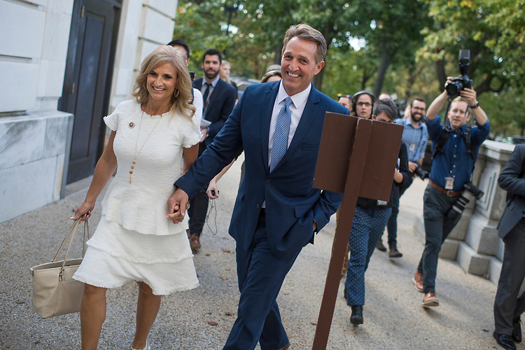 UNITED STATES - OCTOBER 24: Sen. Jeff Flake, R-Ariz., and his wife Cheryl, enter Russell Building on the day he announced he will not be running for re-election on October 24, 2017. (Photo By Tom Williams/CQ Roll Call)