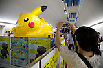 "A visitor takes a picture of Pikachu at the ""1000 Pikachu Outbreak! at Yokohama Minatomirai"" on August 09, 2014. 1000 Pikachu performed at different areas of Minatomirai in Yokohama during the summer vacation event from August 9 to 17.  (Photo by Rodrigo Reyes Marin/AFLO)"