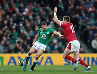 8th February 2020; Aviva Stadium, Dublin, Leinster, Ireland; International Six Nations Rugby, Ireland versus Wales; Jordan Larmour (Ireland) puts in a kick to the corner under pressure from Nick Tompkins (Wales)