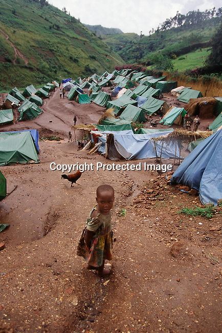 COBURUN35011.Country. Burundi. Refugees. Young boy standing in refugee camp. 96. Civil war..©Per-Anders Pettersson/iAfrika Photos