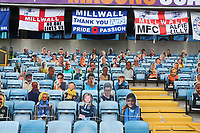 Cardboard cut outs of Millwall fans and supporters' flags in the stand during Millwall vs Swansea City, Sky Bet EFL Championship Football at The Den on 30th June 2020