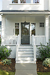 A small covered front porch welcomes visitors to this traditional home.