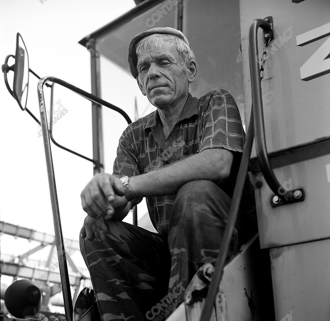 Viktor Parmonov, senior mechanic on the farm of the Resurrection near Mikhailov, Ryazan region. Russia, July 24, 2008.