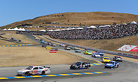 Jun. 21, 2009; Sonoma, CA, USA; NASCAR Sprint Cup Series driver Bobby Labonte (96) leads a pack of cars during the SaveMart 350 at Infineon Raceway. Mandatory Credit: Mark J. Rebilas-