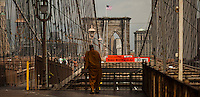 People commute to Manhattan from Brooklyn through the Brooklyn Bridge while it remains under maintenance one day before its 130th anniversary in New York,  May 23, 2013, Photo by Eduardo Munoz Alvarez / VIEWpress.