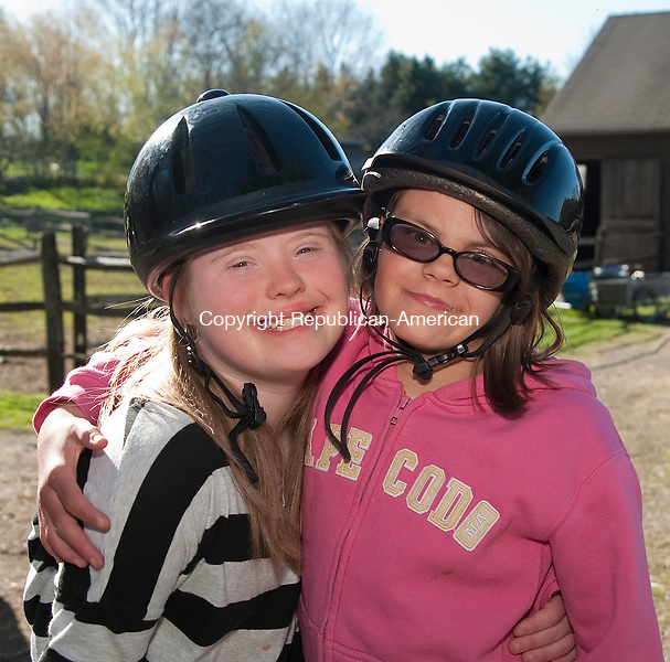 ROXBURY, CT 03 MAY 2013--050313JS09-left, Alicia Crossley, 13, and Anna Bialak, 12, both of Bridgewater, after a ride Friday at Little Britches therapeutic riding center in Roxbury. To honor the memory of Betty Lou McClogin, co-founder of Little Britches, a group has organized a 5K run/walk to raise money for the program. The event will be on Sunday, May 19th in Bridgewater with registration beginning at 8 a.m. with the race going off at 9:30 a.m. There will also be a kids fun run at 11:00 a.m.. Jim Shannon Republican-American