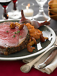 Slice of roast beef with chanterelle mushrooms, onions, and sweet potato puree.