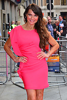 Lizzie Cundy<br /> The &quot;Bula Quo!&quot; UK film premiere, Odeon West End cinema, Leicester Square, London, England.<br /> July 1st, 2013<br /> half length pink dress hands on hips<br /> CAP/BF<br /> &copy;Bob Fidgeon/Capital Pictures