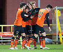 Dundee Utd's Charlie Telfer (2nd left) is congratulated after he scores their first goal.