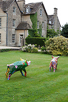 Modern artworks of colourful pigs contrast with the historic backdrop of the Rectory Hotel, Wiltshire