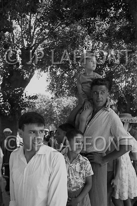 Ecole Militaire d'Infanterie de Cherchell, Algérie, July 14th, 1960. French National Holiday, People of all mixed origin gathering to watch the military parade.