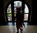 LOUISVILLE, KY - MAY 04: A woman walks by a windown overlooking the Aristides statue on Kentucky Oaks Day at Churchill Downs on May 4, 2018 in Louisville, Kentucky. (Photo by Scott Serio/Eclipse Sportswire/Getty Images)