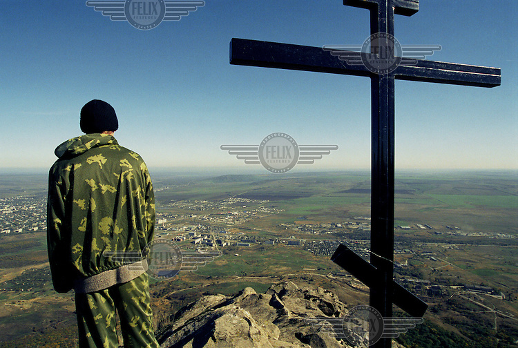 A Cossack cadet looks over the plains, towards the Chechen border while on a routine patrol with the Terek Cossack Army.
