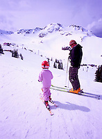 Whistler Ski Resort, BC, British Columbia, Canada - Father and Daughter downhill skiing on Whistler Mountain, Coast Mountains