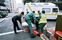 A police officer and paramedics lift an intoxicated man found lying in the road. In the background is the ambulance waiting to transport him to hospital...© SHOUT. THIS PICTURE MUST ONLY BE USED TO ILLUSTRATE THE EMERGENCY SERVICES IN A POSITIVE MANNER. CONTACT JOHN CALLAN. Exact date unknown.john@shoutpictures.com.www.shoutpictures.com....