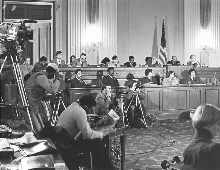 "UNITED STATES - ARCHIVE: CAPTION:..In this 1978 photograph, then Chairman Louis Stokes of Ohio leads a hearing of the Select Committee on Assassinations in the Cannon Caucus Room. In the early 1970's, the public became concerned with accusations and allegations of conspiracy within the U.S. intelligence communities.  Of particular concern were reports of serious and illegal FBI surveillance of various public figures such as the late Dr. Martin Luther King Jr.  These reports alleged that FBI Director J. Edgar Hoover had personally ordered such illegal measures.  Questions were thus raised as to whether there was any involvement by the FBI in Dr. King's murder, as well as whether a proper investigation of President John F. Kennedy's assassination was conducted.With this public pressure, the House of Representatives considered H. Res. 1540 in September of 1976 which would establish a Select Committee on Assassinations.  Although there was not enough time in the 94th Congress to proceed with such an investigation, the House passed the resolution on 17 September 1976.  Speaker Carl Albert of Oklahoma chose Representative Thomas Downing of Virginia to be its first chairman.  After Downing's retirement at the end of the 94th Congress, Representative Henry Gonzalez of Texas took over the chairmanship in 1977.  However, shortly after being appointed chair in early 1977, Gonzalez submitted his resignation on 1 March 1977.  Representative Louis Stokes of Ohio was chosen to be the new chairman until the termination of the committee upon its final report on 2 January 1979.  The committee concluded that there was, ""a high probability that two gunmen fired at President John F. Kennedy,"" and that, ""there is a likelihood that James Earl Ray assassinated Dr. Martin Luther King as a result of a conspiracy.""..  (Office of the House Historian/Roll Call via Getty Images)"