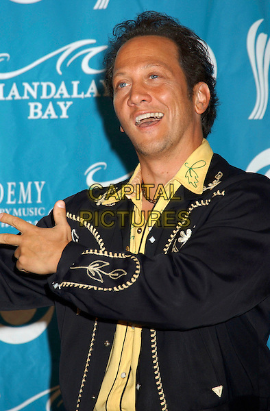 ROB SCHNEIDER.The 40th Annual Academy of Country Music Awards (ACM) held at Mandalay Bay Resort & Casino, Las Vegas, Nevada, USA, 17 May 2005..half length hands gesture funny.Ref: ADM.www.capitalpictures.com.sales@capitalpictures.com.©Laura Farr/AdMedia/Capital Pictures.