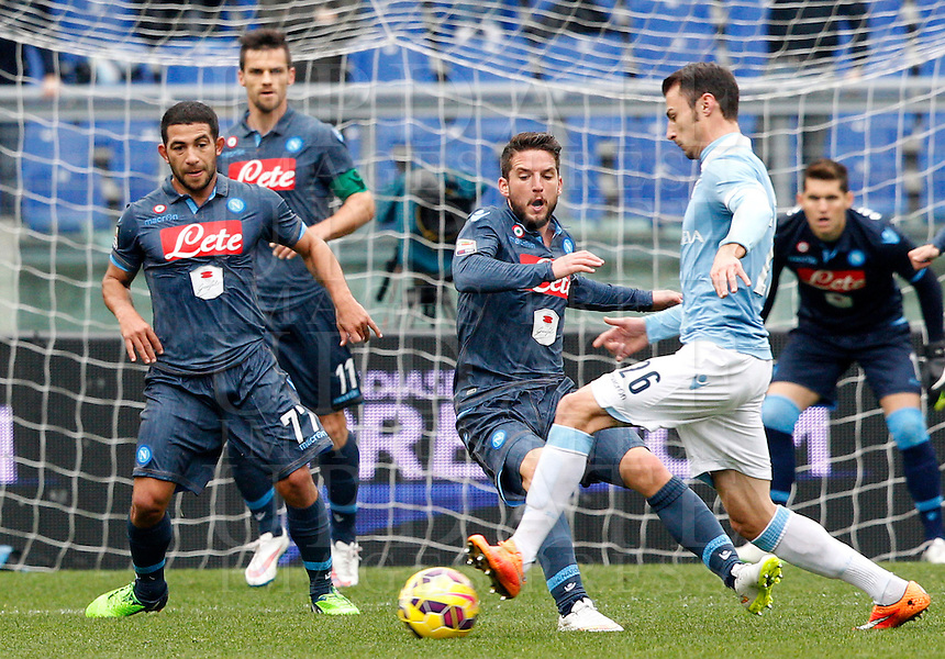 Calcio, Serie A: Lazio vs Napoli. Roma, stadio Olimpico, 18 gennaio 2015.<br /> Lazio&rsquo;s Stefan Radu, right, is challenged by Napoli&rsquo;s Dries Mertens during the Italian Serie A football match between Lazio and Napoli at Rome's Olympic stadium, 18 January 2015.<br /> UPDATE IMAGES PRESS/Riccardo De Luca
