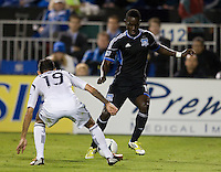 Simon Dawkins of Earthquakes dribbles the ball away from Juninho of Galaxy during the game at Buck Shaw Stadium in Santa Clara, California on November 7th, 2012.   LA Galaxy defeated San Jose Earthquakes, 3-1.