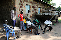 SOUTH SUDAN, Bahr al Ghazal region, Lakes State, town Rumbek , young Dinka men at old battle tank from war between SPLA and north sudanese army / SUED-SUDAN  Bahr el Ghazal region , Lakes State, Rumbek , Djunge inka Maenner am Wrack eines nordsudanesischen Schuetzenpanzers aus dem Buergerkrieg mit dem Sudan an der Rumbek Secondary School
