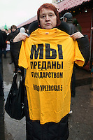 "Moscow, Russia, 04/12/2011..A protester with a t-shirt which reads ""We have been betrayed by the state"" as Russian opposition supporters demonstrate on Manezhnaya square outside the Kremlin calling for a boycott of the parliamentary elections."