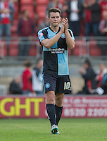 Goal scorer Matt Bloomfield of Wycombe Wanderers applauds the supporters  during the Sky Bet League 2 match between Leyton Orient and Wycombe Wanderers at the Matchroom Stadium, London, England on 19 September 2015. Photo by Andy Rowland.
