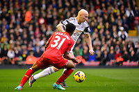 Sunday, 23 February 2014<br /> Pictured: Swansea City's Jonjo Shelvey and Liverpool's Raheem Sterling compete for the ball<br /> Re: Barclay's Premier League, Liverpool FC v Swansea City FC v at Anfield Stadium, Liverpool Merseyside, UK.