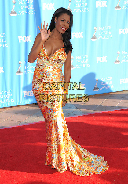 OMAROSA MANIGAULT-STALLWORTH.Attends The 39th NAACP Image Awards held at The Shrine Auditorium in Los Angeles, California, USA..February 14th, 2008        .full length orange yellow silk satin pattern print dress hand palm waving .CAP/DVS.©Debbie VanStory/Capital Pictures.