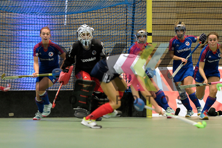 GER - Luebeck, Germany, February 07: During the 1. Bundesliga Damen indoor hockey final match at the Final 4 between Mannheimer HC (blue) and Duesseldorfer HC (white) on February 7, 2016 at Hansehalle Luebeck in Luebeck, Germany.   Nadine Stelter #13 of Mannheimer HC in action