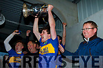 Sean T Dillon hold the Eamon O'Donoghue cup aloft after his team St Senans defeated Ballydonoghue in the North Kerry Championship final played in Moyvane on Sunday.