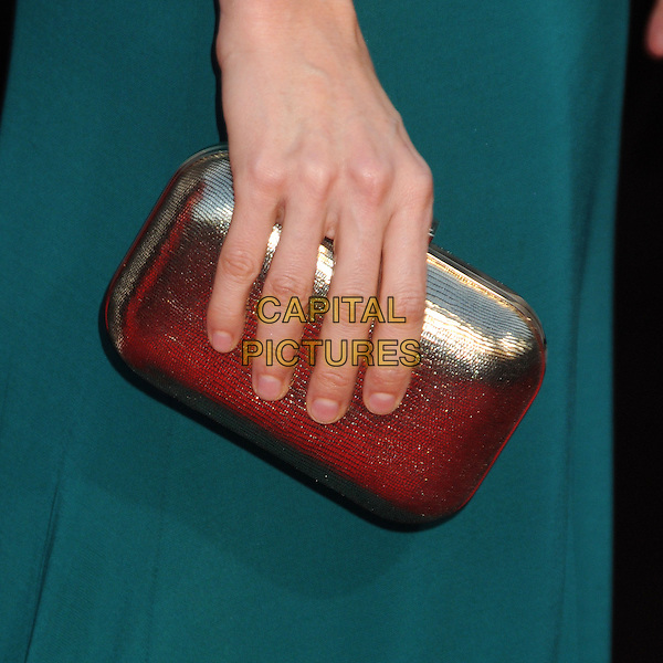 """Heather Graham's hand.""""The Hangover Part III"""" Los Angeles Premiere held at the Westwood Village Theater, Los Angeles, California, USA..May 20th, 2013.green silver clutch bag detail.CAP/ADM/BP.©Byron Purvis/AdMedia/Capital Pictures"""