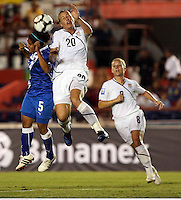 Landy Barrios of Guatemala (L) and Abby Wambach of USA (R) at the 2010 CONCACAF Women's World Cup Qualifying tournament held at Estadio Quintana Roo in Cancun, Mexico.