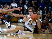 Ricky Kreklow of California controls the ball away from Pepperdine defenders during the game at Haas Pavilion in Berkeley, California on November 13th, 2012.  California defeated Pepperdine, 79-62.