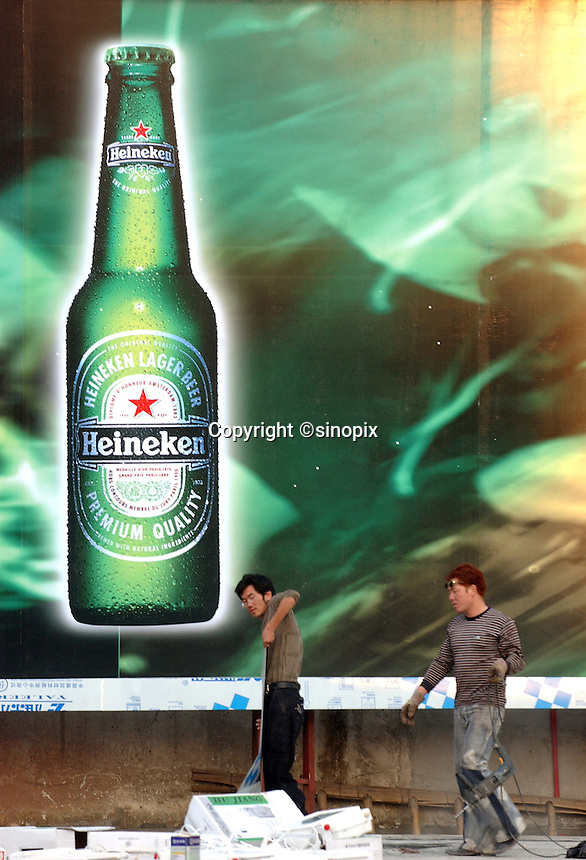 Heineken beer advertising billboard at the industrial town Changping on the Pearl river Delta of Guangdong Province, China..