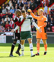 Sheffield United VS Barnsley FC EFL CHAMPIONSHIP <br /> Saturday 19th August 2017, Bramall Lane Sheffield<br /> <br /> Barnsleys Angus McDonald lands a headbut on Sheffield Uniteds Leon Clarke <br /> <br /> Picture - Alex Roebuck / www.alexroebuck.co.uk