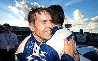 Scott Pruett and Memo Rojas celebrate after thier victory in the EMCO Gears Classic at the Mid-Ohio Sports Car Course in Lexington, OH, June 2010.  (Photo by Brian Cleary/www.bcpix.com)